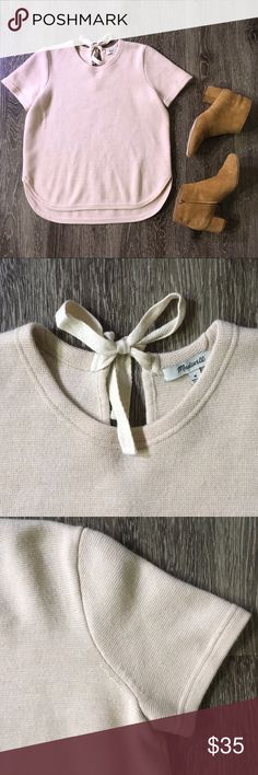 EUC Madewell blush wool sweater The details make this sweater! It has a high-low hem with curved edges and a bow that ties at the back of your neck. The color is a pale blush pink, closest to the first picture. The material is a soft (not scratchy) wool blend that is thick enough for spring and fall. No noticeable pilling that I can find. Measures about 19 inches pit to pit. Smoke-free home. Price firm unless bundled-thanks for shopping my posh closet that helps support my dissertation…