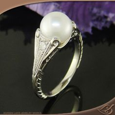 Antique Style Mounting with a freshwater pearl...very elegant and down to earth