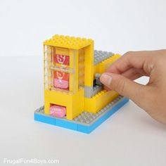 How to Build a LEGO® Candy Machine {Dispense One Candy at a Time!} - Frugal Fun For Boys and Girls How to Build a LEGO® Candy Machine {Dispense One Candy at a Time!} – Frugal Fun For Boys and Girls Lego Minion, Lego For Kids, Diy For Kids, Crafts For Kids, Kids Fun, Diy Crafts, Candy Dispenser, Jelly Beans, Legos