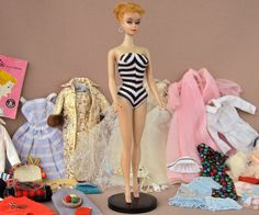 #1 1959 Vintage Barbie with stand & wardrobe Can I have her wardrobe in human size?