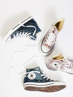 Metallic Hi Top Chucks | Step out in these shiny Converse high-top sneakers with a metallic design perfect for the season. Dressed up or down, these cool kicks are bound to make a statement.
