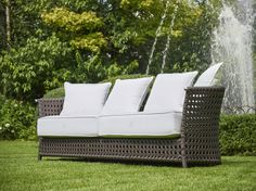 WEZEN Sofa by Samuele Mazza Outdoor Collection. Luxury outdoor furniture in synthetic wicker and rattan produced and distributed by DFN Srl. Suitable for garden, pool, wellness area, spa, patio, terrace, veranda, balcony, sundeck, courtyard, porch, lanai, boat, yacht and ship.