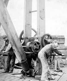 Old photograph of shipyard workers in Glasgow, Scotland