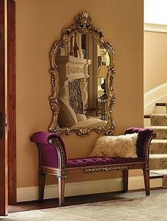 A stunning piece sure to become a focal point in your home, the Chantal Wall Mirror boasts a grand scrolled-edge design and is an elegant addition to any room.