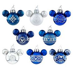 Disney Mickey Mouse Icon Ornament Set - Blue | Disney StoreMickey Mouse Icon Ornament Set - Blue - Deck the halls with a mouse that's jolly! Our miniature glass Ornament Set includes 8 glittering Mickey icon ornaments in blue and silver, perfect for a tiny table top tree or a towering pine giant!