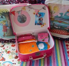dollhouse suitcase, blue 7 inch TWE doll, 4 pets.  one extra outfit & sweater.  This set will be from Mommy & Daddy, all the rest from santa