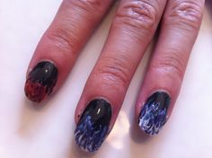 Hunger games nail art.  Black base coat, let dry completly.  Blob blue polish on the tip and drag up with a needle. Repeat process with different colors. Act fast because polish can't dry between colors!  Add top coat when dry and voila. Easy to do flame art!