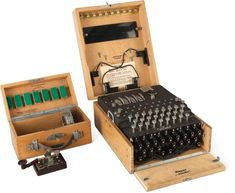 ENIGMA fully operational four-rotor Kriegsmarine Enigma Cipher Machine.Berlin-Wilmersdorf, Germany, Heimsoeth und Rinke, from theBauau Enigma Machine, Boat Radio, Light Panel, Prisoners Of War, Trondheim, German Army, Leather Handle, Black Backgrounds, Norway