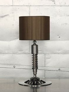 #BeautifullyUpcycled - This upcycled lamp by Betsy Ryland is made from motorcycle parts.