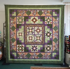 Patchwork Party 2012 - This design balances symmetry with functionality in this beautiful quilt from Fabric Essentials!