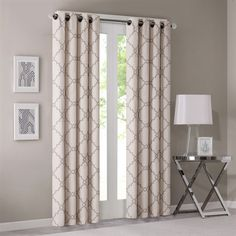 "Refresh your room with the decorative fretwork window panel. The scroll geometric print is simple yet trendy, featuring a light beige ground with a soft grey fretwork for a natural update. The panel is made with a cotton blend basket weave fabric softly filtering the perfect amount of sunlight into your home. Grommet top detail makes it easier to hang, open, and close panels throughout the day.  Fits up to 1.25"" diameter rod."
