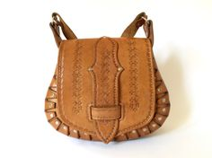 Vintage 1970s hand tooled tan leather saddle by TheCrownStProject