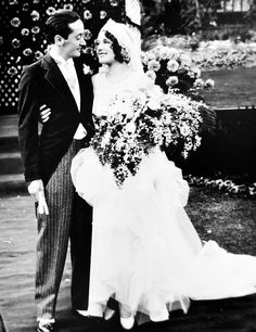 Norma Shearer and Irving Thalberg on their wedding day in 1927.    (via tracylord)