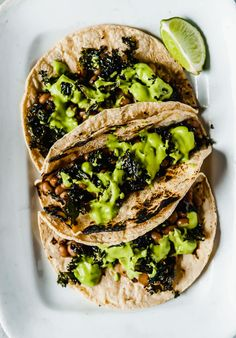 These black eyed pea and kale tacos are the perfect vegan dinner! Topped with a super easy avocado jalapeno sauce that comes together in a snap.
