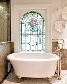 Love the stained glass window in this bathroom.