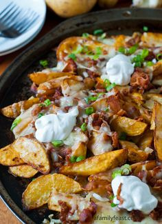 Loaded Pub Fries | www.afamilyfeast.com | #appetizer   These Loaded Pub Fries are out of this world!  Baked potato wedges smothered in cheese, bacon and sour cream and seasoned with smoked paprika.  These are the best I've ever had!