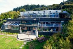 modern earthship home on two floors. Earthship Plans, Earthship Design, Earthship Home, Sustainable Architecture, Architecture Design, Residential Architecture, Contemporary Architecture, Building Design, Building A House