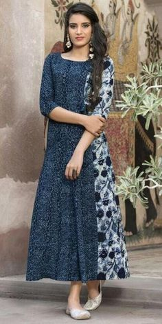 Best to buy this affable a-line shaped appealing blue off white cotton kurti. sleeves, scoop neckline, geometrical & floral print is highlighting it. Salwar Pattern, Kurta Patterns, Dress Patterns, Indian Attire, Indian Outfits, Salwar Designs, Dress Designs, Batik Dress, Indian Designer Wear