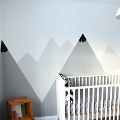 Looking for an amazing kids room or nursery decor idea? DIY this painted mountain range mural - easy and budget friendly!