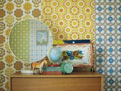 various rolls of vintage inspired wallpaper would dress up any retail window or display.