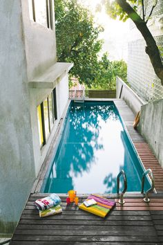 This pool at a home in Hong Kong is made for relaxing in the summer sun. Home Journal, June 2017. Photography: Mitchell Geng. Styling: David Roden.