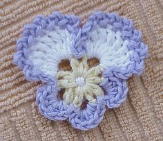Crocheted pansy  http://www.flickr.com/photos/crochetbouquet/