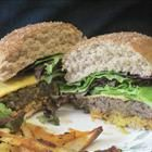 black bean burgers! Sooo much better than store bought, and so easy to make. Delicious with vegenaise, chili sauce, and clover sprouts.
