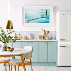 Love the idea of art in the kitchen. And especially if the kitchen is mint!  @Real Living Magazine