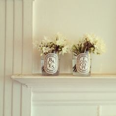 Use old candle holders as cases. Love the writing/label with the white flower