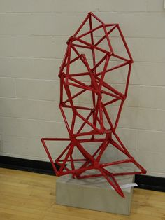 This is a sculpture made out of newspaper, tape and spray paint and is as tall as the artist. Simple, cheap materials that could be a cool collaborative project in the geometric art unit for 8th grade.