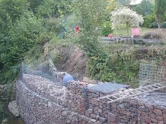 example of our gabion baskets used to solve a river erosion problem. Gabion wall is curved. Gabion Retaining Wall, Building A Retaining Wall, Colorado Landscaping, Gabion Baskets, Brick Steps, Mesh Fencing, Dry Stone, River Bank, Garden Pictures