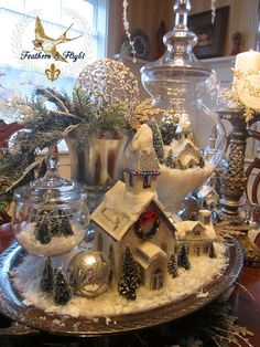 Glass apothecary, snow, mica house, mercury glass, greenery & glitter vignette!! Anything goes when the colors all match!