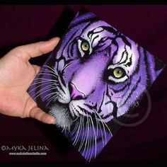 """Putting the final touches today on my little tiger. Her name is """"Fiala"""" and the original painting and prints of all sizes will be available very soon here. http://etsy.me/1Rv89UV Done in acrylic paint on a 6x6 inch masonite panel. #tiger #mykajelina #purple #violet #bigcats"""