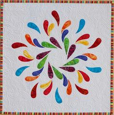 Sampaguita Quilts - THIS IS COOL!!!  Would be so pretty in peacock colors, like the fanned feathers of a tail!