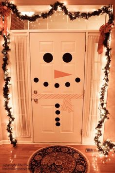 Start by decking out the door you use most — you can make Frosty the Doorman here with just a few supplies. | 15 Borderline Genius Christmas Decorating Ideas For Your Tiny Space