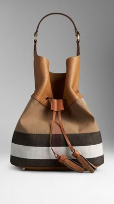 Large Canvas Check Hobo Bag from Burberry - Jute cotton hobo bag in Canvas check with a grainy leather panel. Open top with tasselled drawstring closure. Leather shoulder strap with vintage-finish metal hardware. Interior detachable purse pocket Leather b Leather Tassel, Leather Bag, My Bags, Purses And Bags, Fashion Bags, Fashion Accessories, Luxury Bags, Hobo Bag, Swagg