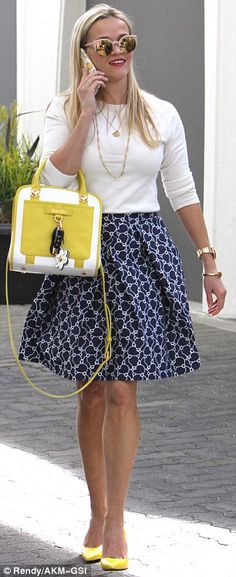Reese Witherspoon street style with yellow bag, white top and floral skirt