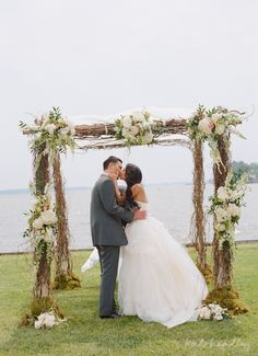 Branch chuppah with white flowers. Not sure this would work if the ceremony had to be indoors.