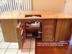 Cherry Amish sewing cabinet with wood pull out drawer
