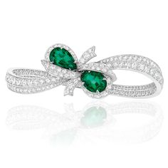 Dior's Milieu du Siecle Diamant bracelet has two emeralds wrapped in a bow of diamonds that curves around the wrist (POA). The Dior earrings from the Milieu du Siecle Diamant collection suspend diamond bows and blue sapphires off the ear (POA). Bayco's M Emerald Bracelet, Emerald Earrings, Emerald Jewelry, Diamond Jewelry, Dior Jewelry, Jewelry For Her, Jewellery, Emerald Ring Vintage, Dior Earrings