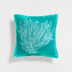 Image of the product Coral print turquoise linen cushion cover