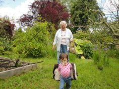 Grandma Jane chasing Ladybug through the garden