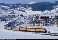After laying over in the siding at Fraser, Colorado, as the skiers enjoy some powder on the slopes, the Rio Grande Ski Train now departs eastbound to pick up the tired passengers at Winter Park on the afternoon of February 9, 2001.