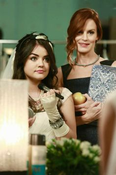 "Lucy Hale as Aria Montgomery and Laura Leighton as Ashley Marin - Pretty Little Liars ""Unbridled"" - air on March 11, 2014."