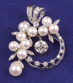 Diamond and Cultured Pearl Brooch, set throughout with full and single-cut diamonds and pearls, centering a prong-set old European-cut diamond drop weighing approx. 1.25 cts, 14kt white gold mount, lg. 1 5/8 in.