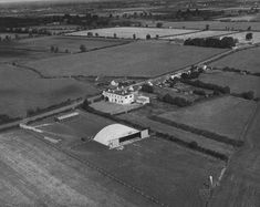 The completed Iona hangar at Dublin airport in then catering for up to 8 aircraft. The hut, near the road, was used by Irish Air Charters and Iona for storage. The Boot Inn pub located to the rear. Dublin Airport, Air Charter, Old Photos, Catering, Irish, Aircraft, Times, Storage, Image