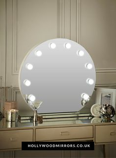 Round Hollywood Mirror | Makeup Mirror with Lights | Dressing Table Mirror with Lights | Vanity Mirror with Lights | Illuminated Makeup Mirror | Holllywood Mirror UK | Light Up Makeup Mirror | Hollywood Mirrors | Mirror Diameter 70cm x Depth 6cm | https://www.hollywoodmirrors.co.uk/products/round-hollywood-mirror This round handmade Hollywood mirror is the ultimate statement glamorous piece for your boudoir or dressing room. The perfect illumination helps give you flawless makeup and hair!