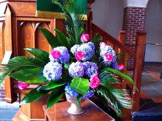 Team 2 (Karen and Mary) altar flowers 6-28.  Aspidistra, roses, sego palm and hydrangea.
