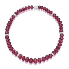 RUBY BEAD AND DIAMOND NECKLACE. Composed of 50 ruby beads spaced by rondelles set with round diamonds weighing approximately 3.80 carats, mounted in 18 karat white gold, length 17 inches.