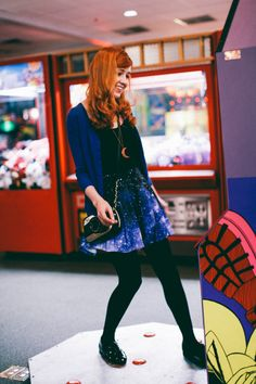 For some reason, I just admire this picture. Maybe it's the fact that she's in an arcade playing one of those dance games, or it could be the vintage camera hanging off her shoulder, or her gorgeous hair, or her outfit...just fantastic.